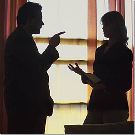 silhouette of businessman and woman debating
